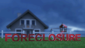 picture of a home with a foreclosure sign in the front yard